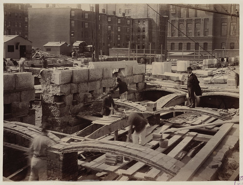 Rafael Guastavino stands on recently laid tile arch along Boylston Street, construction of the McKim Building | by Boston Public Library