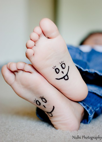 ... kid feet with happy smiley face drawn on bottom | by Nidhi Photography: https://www.flickr.com/photos/nidhiphotography/5865687738