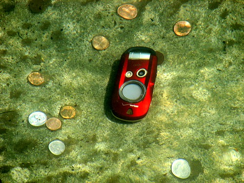 Cell Phone and Coins in Water | by brokinhrt2