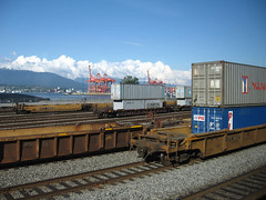 freight containers on rail and hoists | by Brain Power