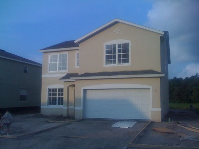 Front Of House With Garage And Medallions Notice The