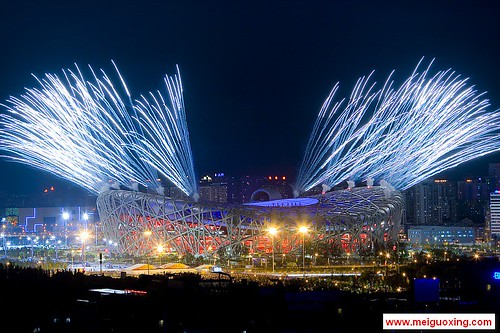 Fireworks explode over the Beijing National Stadium - Bird's Nest during the opening ceremony of the Beijing 2008 Olympic Games | by Meiguoxing