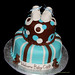 Brown and blue 2 tier baby shower cake with baby shoes and bears