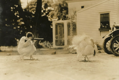 Woman Aiming Gun at a Turkey | by Foxtongue
