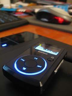 SanDisk Sansa Clip on my Wacom Bamboo on my wooden desk (top) | by Iwan Gabovitch