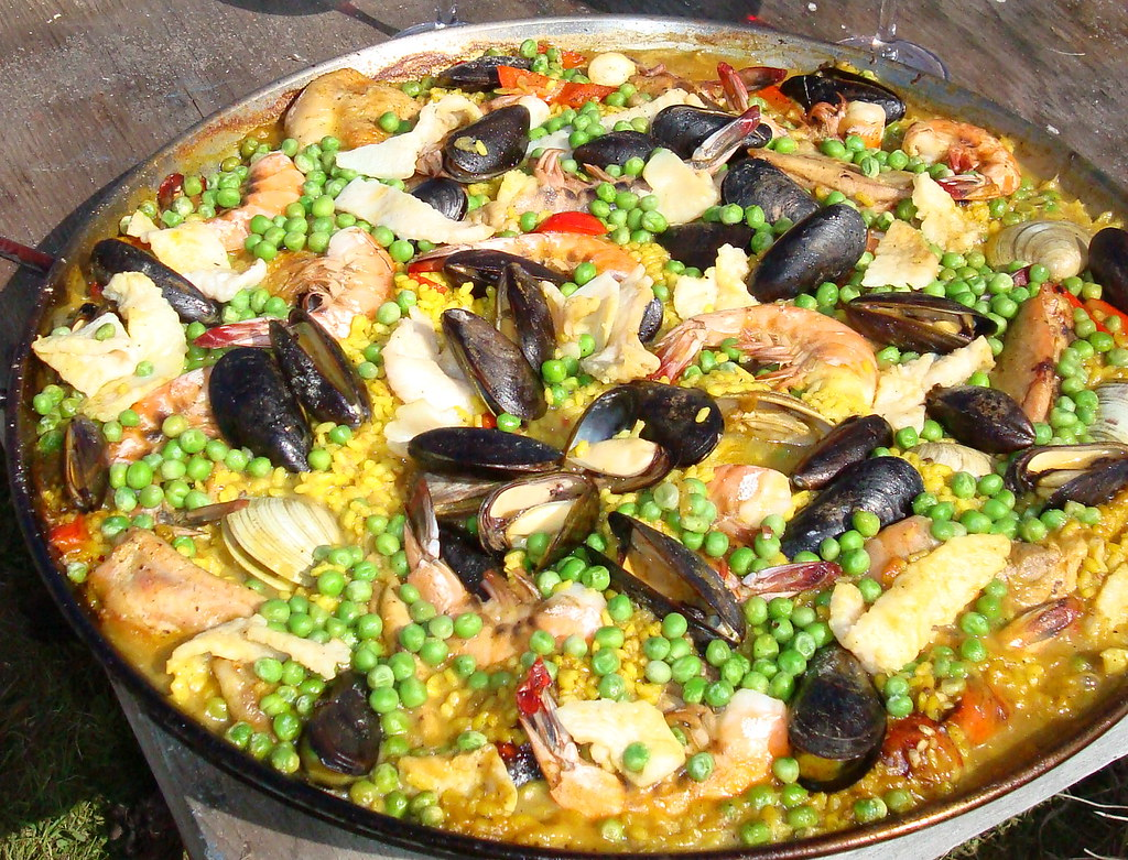 Paella Paella Mixta Cooked Over An Open Fire Pit On The