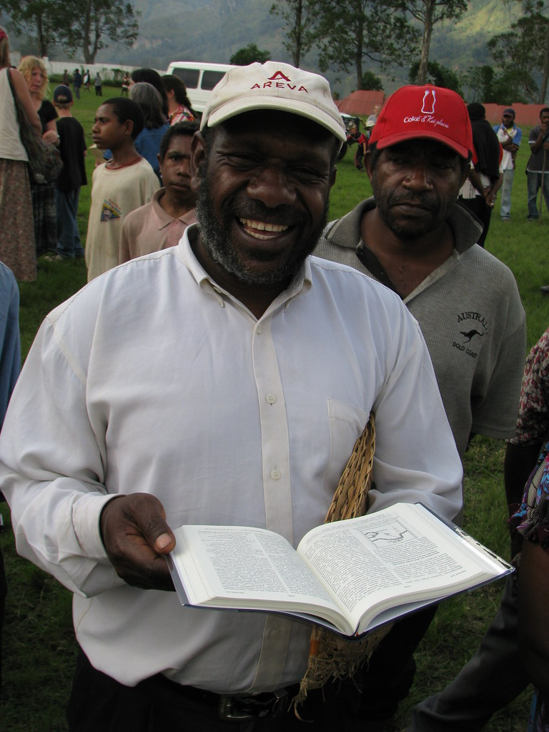 Happy man with Bible he can read   The Kuman people number ...