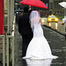 Wet bride and groom