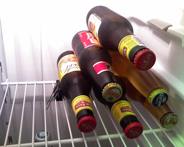Use a binder clip to keep beer stacked