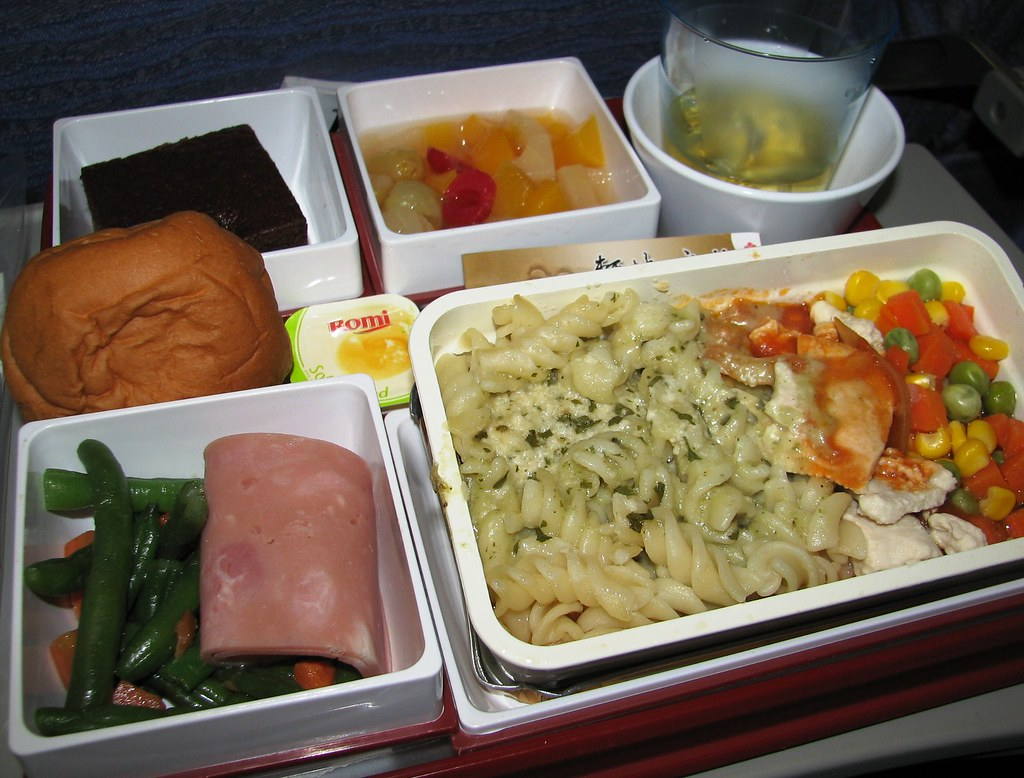 China Airlines Economy Class Dinner Congee And Orange