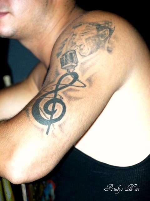 Musical notes and singer arm tattoo by brooklyn ink flickr for Club ink tattoo brooklyn