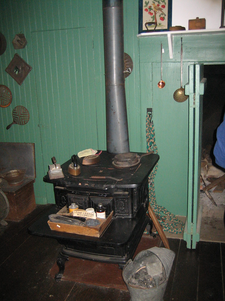 Mid to late 19th century kitchen stove next to earlier coo for 19th century kitchen cabinets
