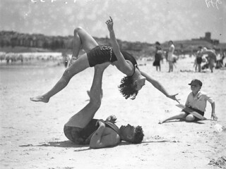 Mr J Prentice and Miss J Howat doing acrobatics, Bondi Beach, Jan 1935 / by Ted Hood | by State Library of New South Wales collection