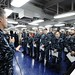 Capt. Stephen Koehler addresses newly promoted Sailors during a frocking ceremony .
