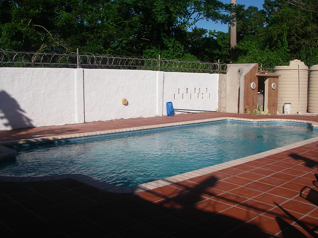 Paradise home swimming pool for Garden pool dennis mcclung