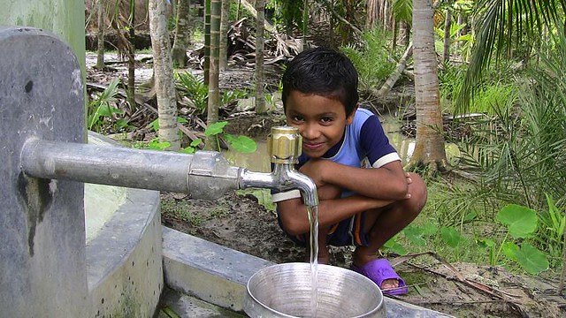 A boy fills up his bucket with Clean drinking water