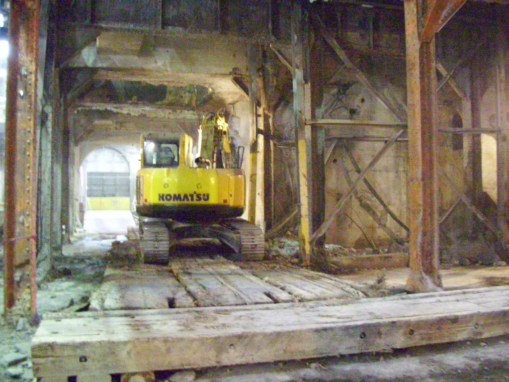 Excavator on crane mats demolishes interior structures for Floor 4 mini boss map swordburst 2