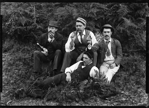 Four well-dressed men holding beer bottles | by Powerhouse Museum Collection