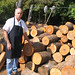 Dale Pettit at the wood pile at Top Hat Barbecue
