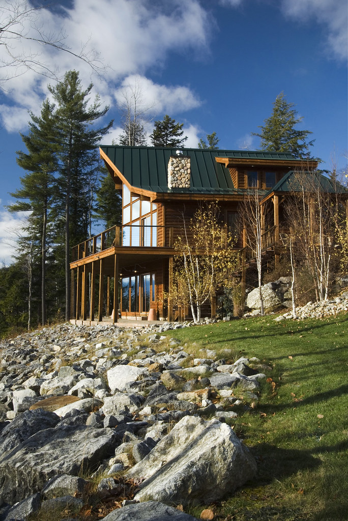 Prow front overlooking ski area featured in maine home for Prow front house plans