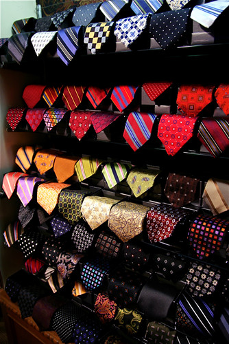 Elaborate tie rack in closet with colourful silk ties