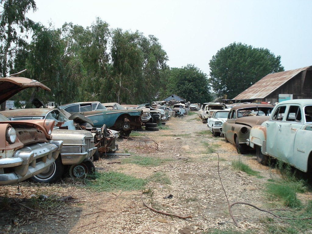 old cars at the yard ca old cars at a salvage yard in nor flickr. Black Bedroom Furniture Sets. Home Design Ideas