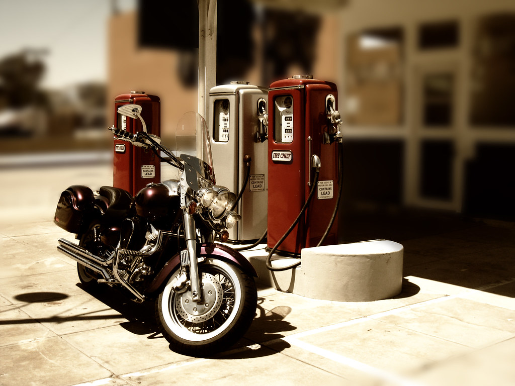 old time gas station and a hand built motorcycle