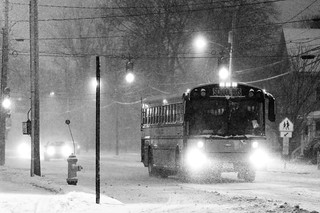 "School Bus Approaching (""Kids forced to go to school in snow storm."") 