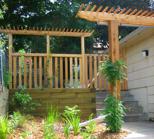 Custom fence and japanese style pergola with rain garden a for Fence with arbor