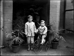 Two small boys, one on tricycle | by Powerhouse Museum Collection