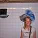 Trying On Hats in the Subway