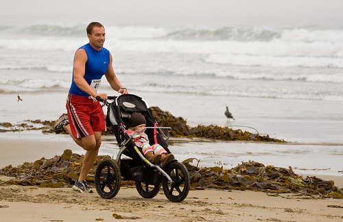 Man running while pushing a baby trike - Runners at 1st Annual Rock 2 Rock 5 Mile Fun Run | by mikebaird