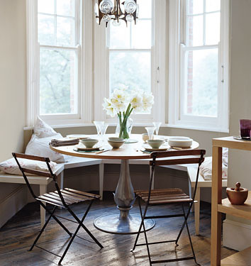 pale green dining area pedestal table banquette seating