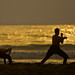 Two Surfers do Pre-stretches on Morro Strand State Beach prior to a sunset surf session - Not Tai Chi