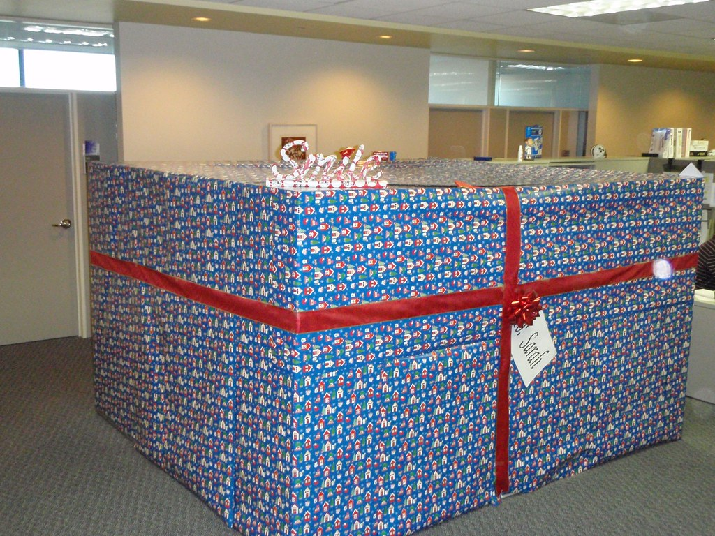 Cubicle Wrapped With Christmas Wrapping Paper The Top