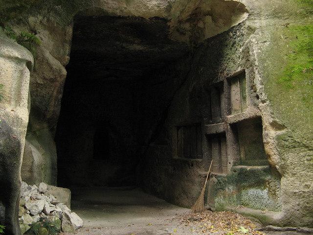 Man Carves Cave With Dog : Caves carved into rock explore one man walking s photos