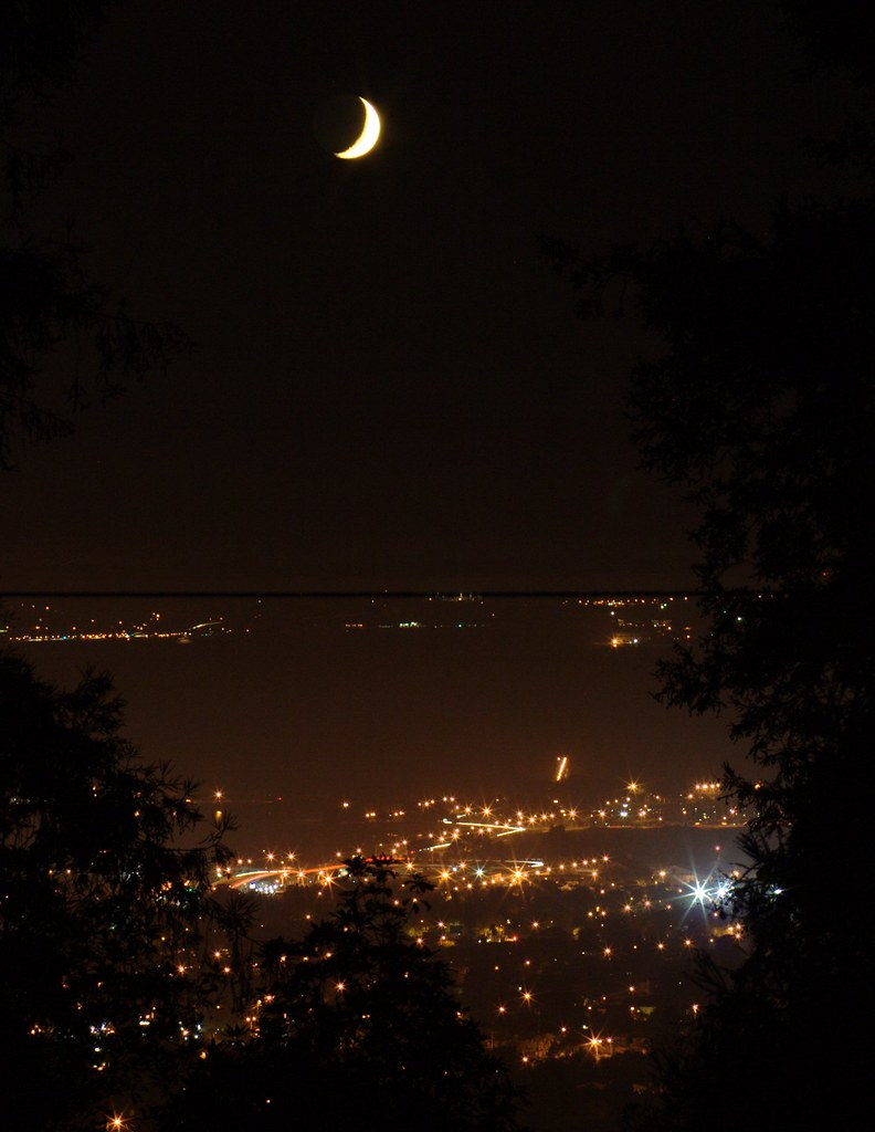 Moon over Berkeley, and a lot of stray light.  Image credit: laikolosse (CC-BY-NC).