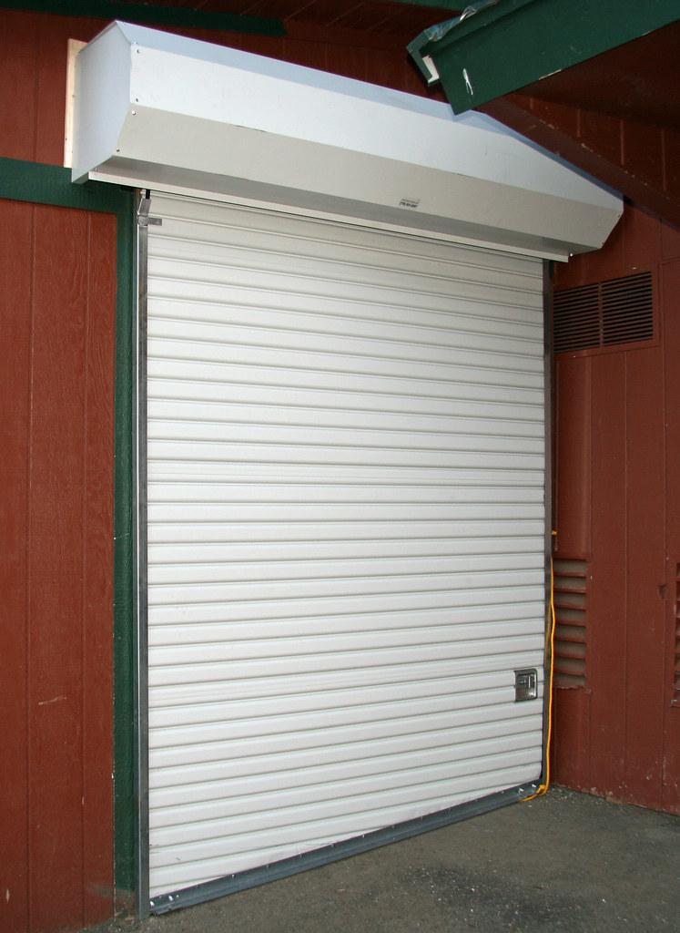 porvene roll up door outside mount w hood cover flickr