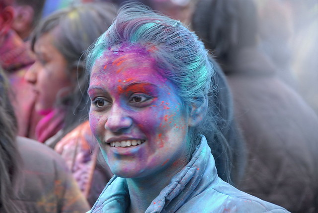 person with colored powder on face