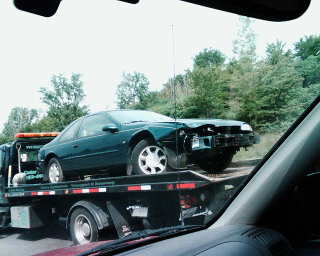 Towed Car Finder >> Car being towed | Wrecked cars being towed. I don't know ...