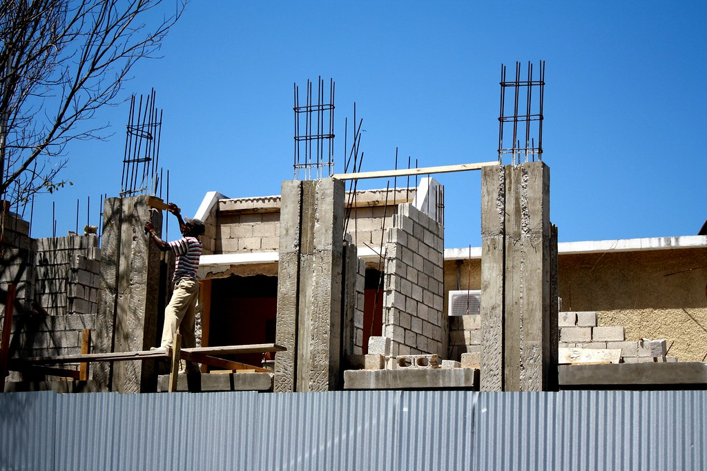 House construction in jamaica a man building a house in for Building a house in jamaica