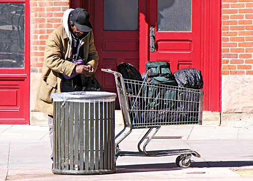 Trashcan and a Homeless Man | by St Stev