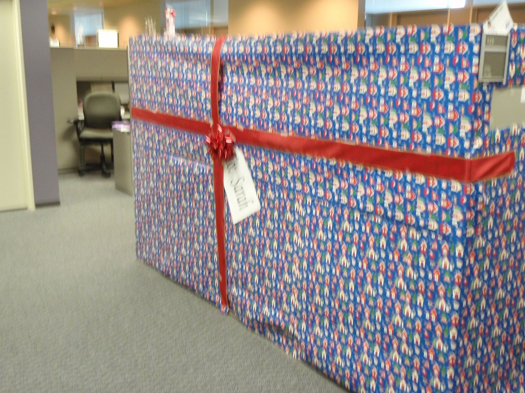 Cubicle Wrapped With Christmas Wrapping Paper Finished