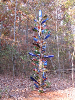 all colored bottle tree in our woods | by nokidsjustcats