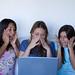 three woman shoppping at the web