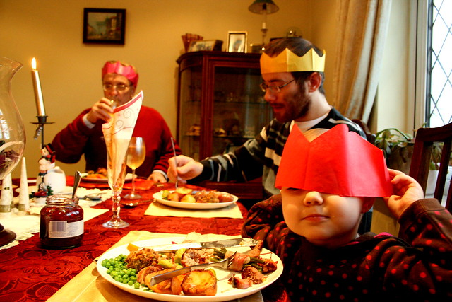 an english christmas dinner complete with paper crowns