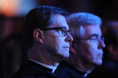 Members of the Saint Anselm Abbey watch the debate