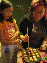 Izzy and Christine flipping the takoyaki | by tricksn26treats