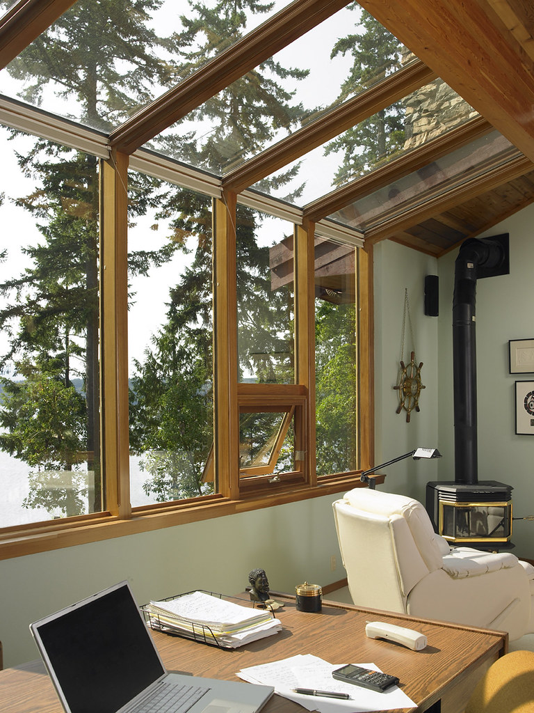 Home Office In Sun Room This Large Sunroom Allows The