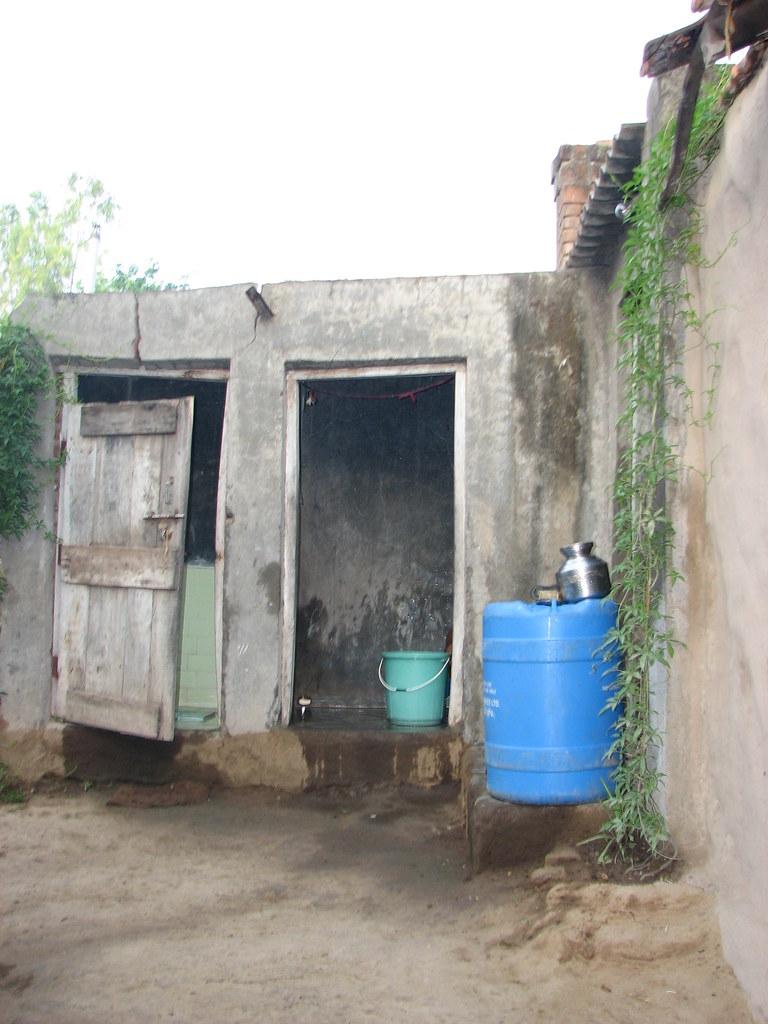 Toilet and bathroom in tambhol village india toilet and for Village bathroom photos